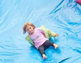 Girl on giant inflatable slide