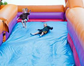 Jumping and sliding down the giant inflatable slide