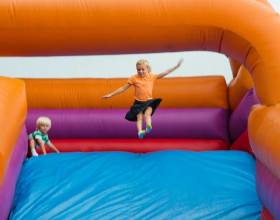 Jumping to slide down giant inflatable slide