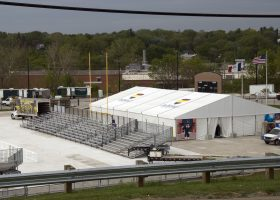 Ashford University graduation ceremony with tents and bleachers