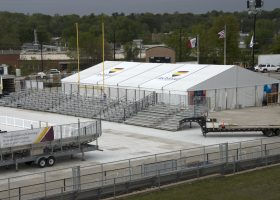 Bleachers and clearspan tents at Ashford University graduation ceremony