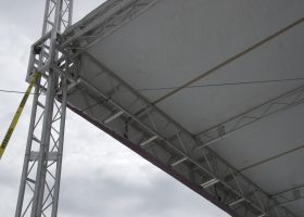 Truss roof above stage at Ashford University graduation ceremony