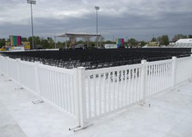 White fence and Black chairs at Ashford University graduation ceremony