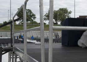 Stage with guard rails at Ashford University graduation ceremony