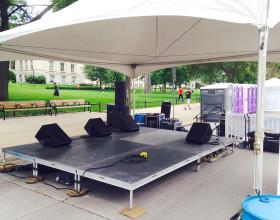 12′ x 16′ stage under tent.