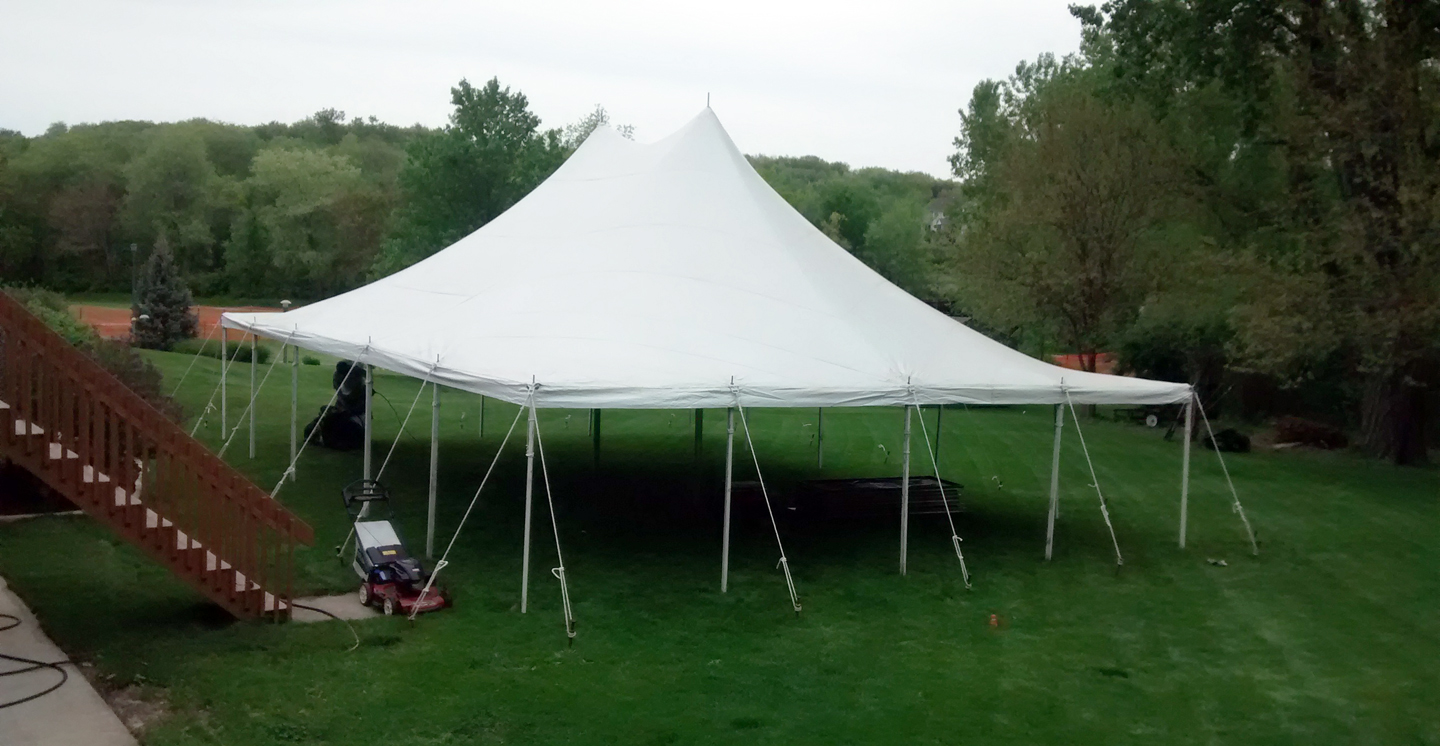 Above view of 30u2032 x 40u2032 Rope and Pole tent setup for a backyard high school graduation party. & 30u0027 x 40u0027 Rope and Pole Tent Rental in Iowa City Cedar Rapids