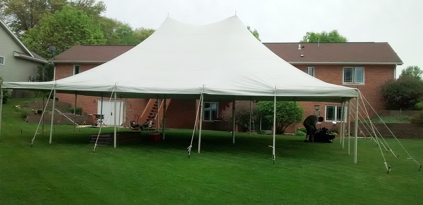 Party Tent In Backyard :  Rope and Pole tent setup for a backyard high school graduation party