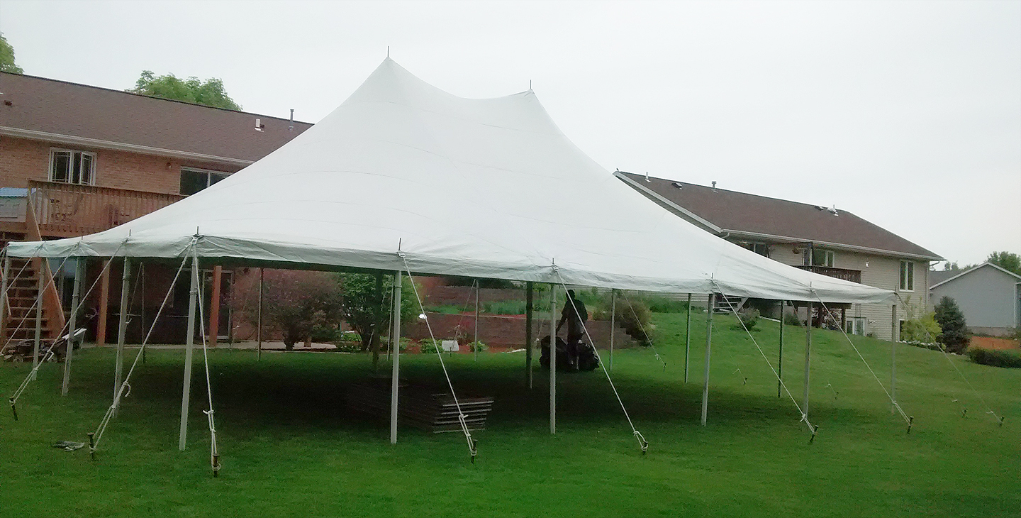 Side view 30u2032 x 40u2032 Rope and Pole tent setup for a backyard high school graduation party. & 30u0027 x 40u0027 Rope and Pole Tent Rental in Iowa City Cedar Rapids