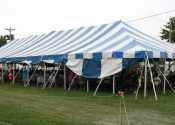 40′ x 100′ blue and white rope and pole tent with stage