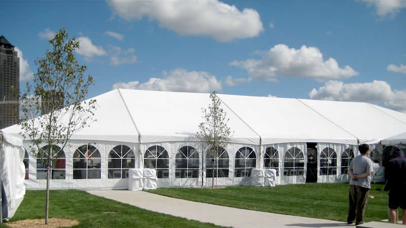 Outside view of our 40' x 100' hybrid event tent shown with french side walls installed.