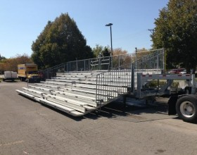 45′ long towable hydraulic bleacher unfolded.