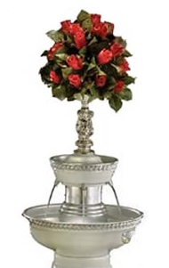 "Picture of our 5 gallon Apex white dove champagne fountain that is 31"" tall. (Floral arrangement not included)"