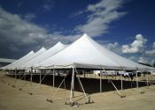 Outside view of the 60′ x 150′ Rope and Pole tent made by Genesis.
