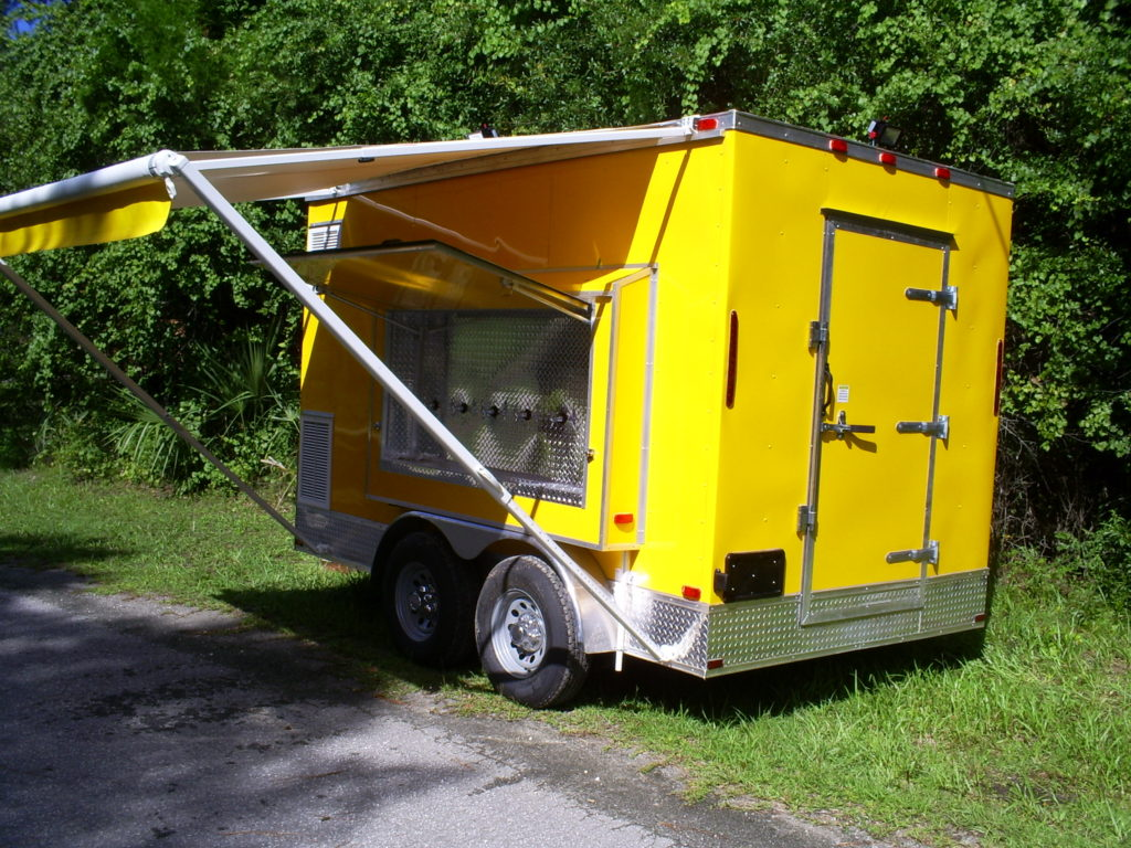 Back and side of the new multi beer tap trailer for sale with awning out