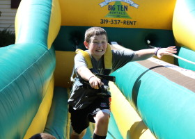 Boy marking spot on bungee run challenge inflatable