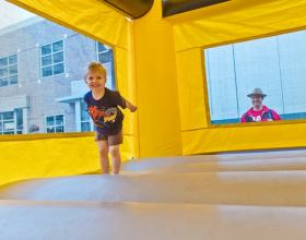 Child playing in our Big Ten Sports themed bounce house