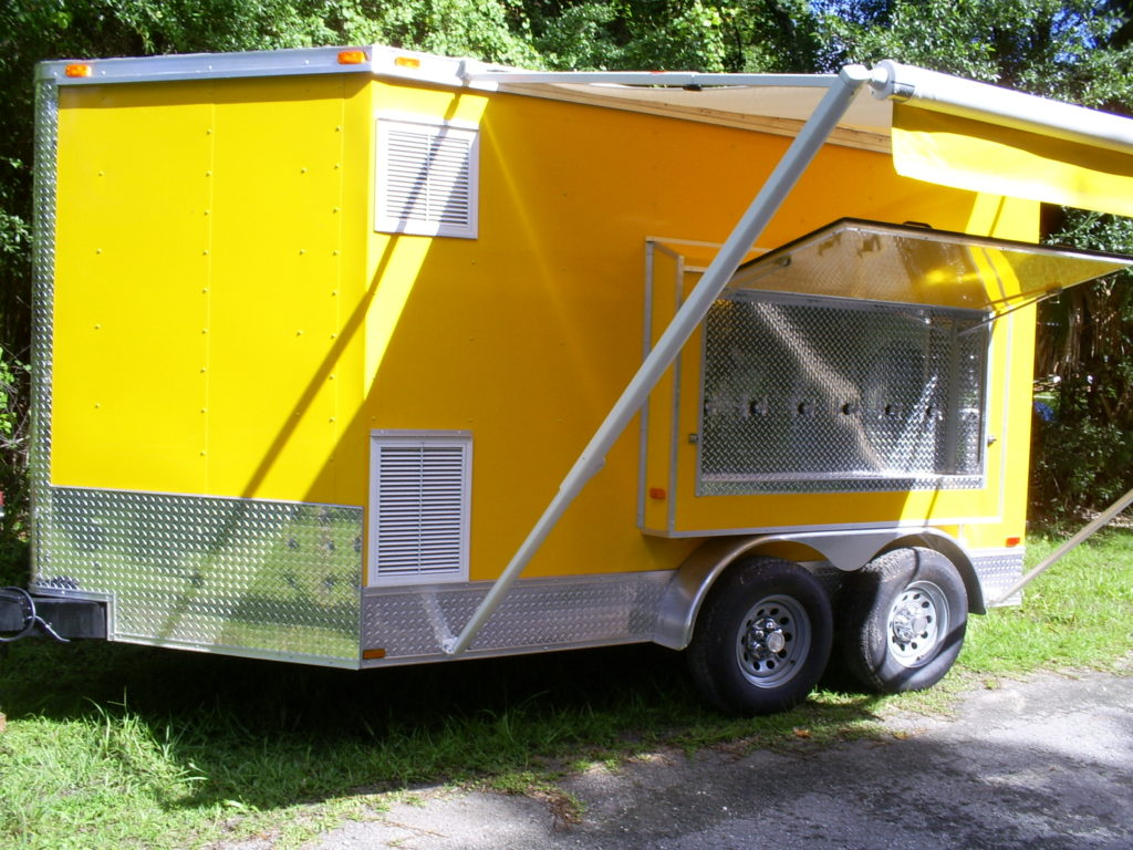 Front and side of the new multi beer tap trailer for sale with awning out