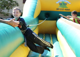 Jumping on bungee run challenge inflatable