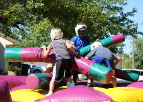 Kids having fun with Rock'em Sock'em inflatable game