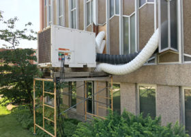 Rented 12-ton Air Conditioning unit on a raised platform keeping a Church cool