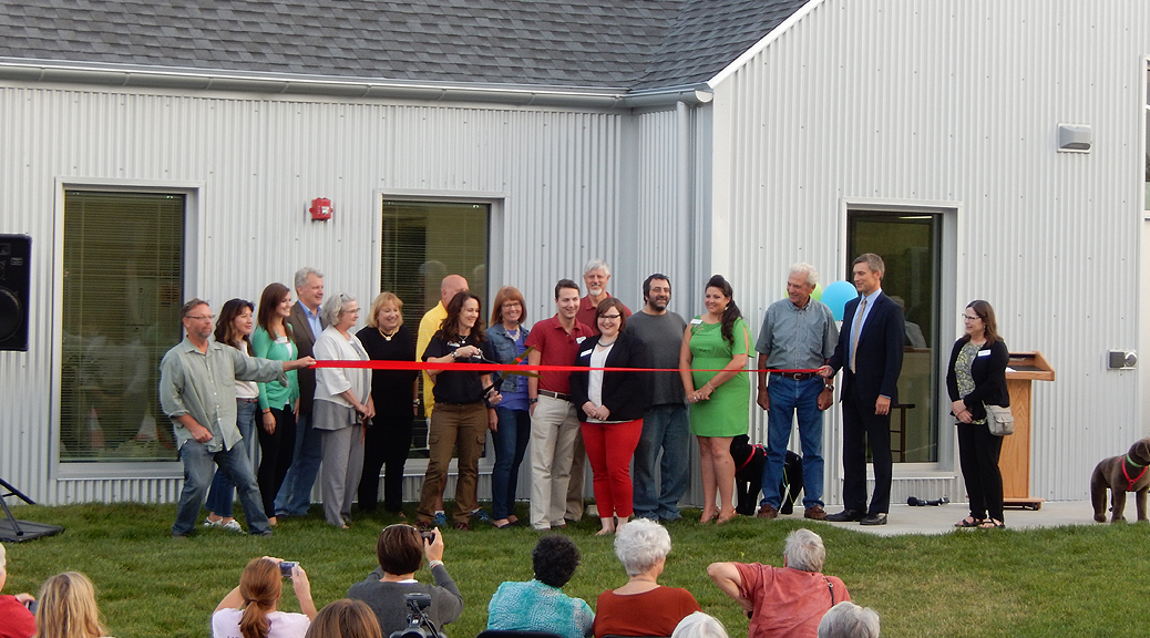 Ribbon Cutting ceremony with Giant Scissors at the Iowa City Animal Care and Adoption Center