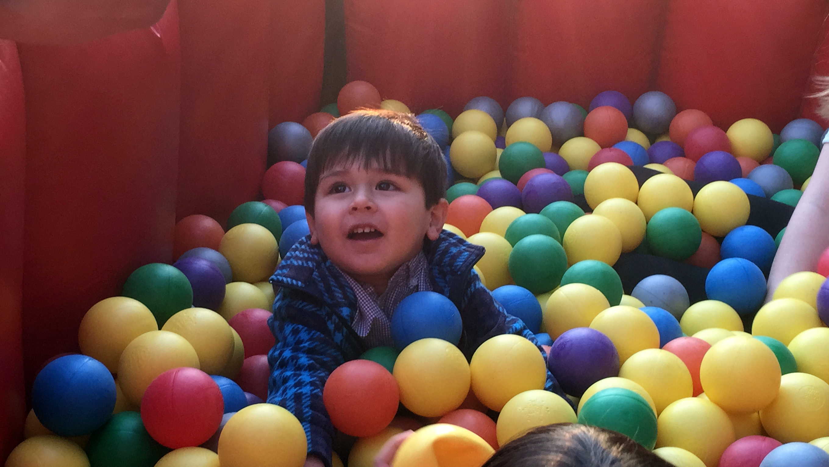 Picture of a toddler inside the ball crawl provided by our customer.