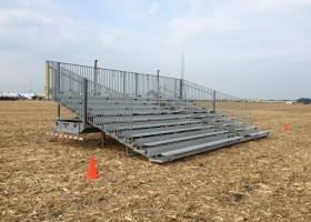 Towable 10-Row 30′ Hydraulic Bleachers at Farm Progress