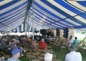 Custom stage under 40′ x 100′ blue and white rope and pole tent.jpg