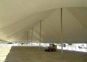 Under the 60′ x 150′ Rope and Pole tent made by Genesis.