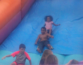 kids-enjoying-the-giant inflatable-slide