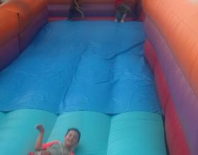kids-enjoying-the-giant inflatable-slide-rental