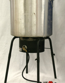Large Cajun cooking pot with strainer and propane burner.