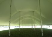 Standing in the middle of the huge 80′ x 150′ Rope and Pole event tent.