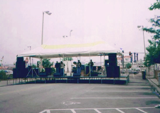 Rent our stage with covering for your next all weather event.