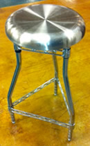 Stylish stainless steel bar stool for rent.