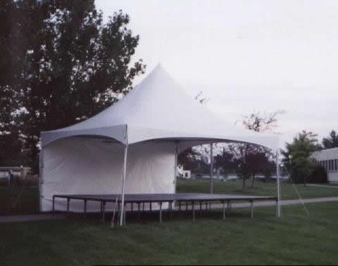 "Rent our ""Tent over a Stage"" for small- to medium-sized stage events. This is a 16' x 20' stage."