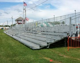 Three, 45′ long, 10-Row Hydraulic Bleachers in a row.