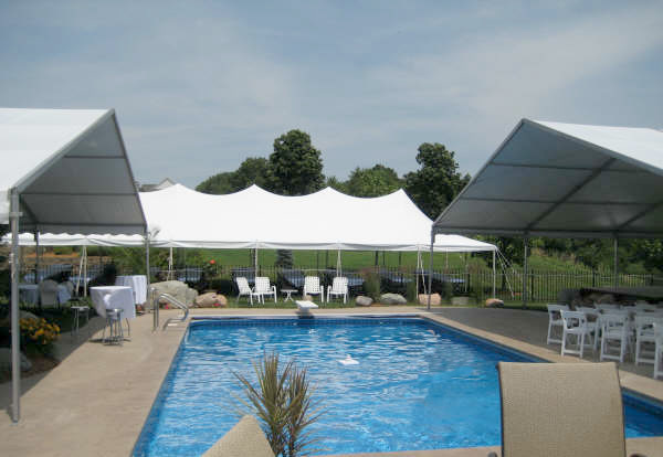 Wedding event tents erected around the pool.