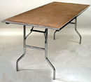 "8' x 30"" wooden rectangular banquet table."
