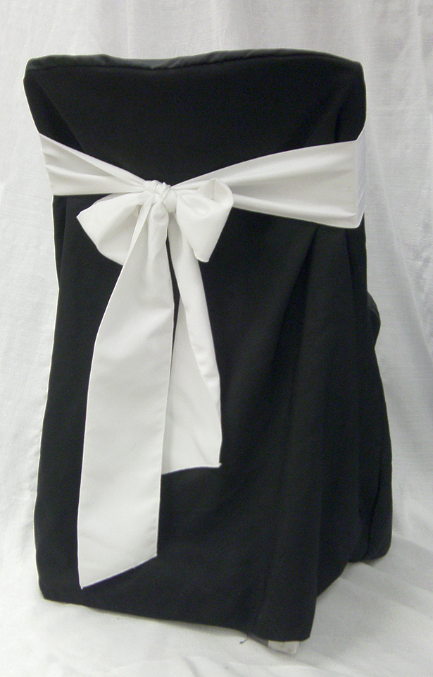black linen chair cover rental with white bow wedding
