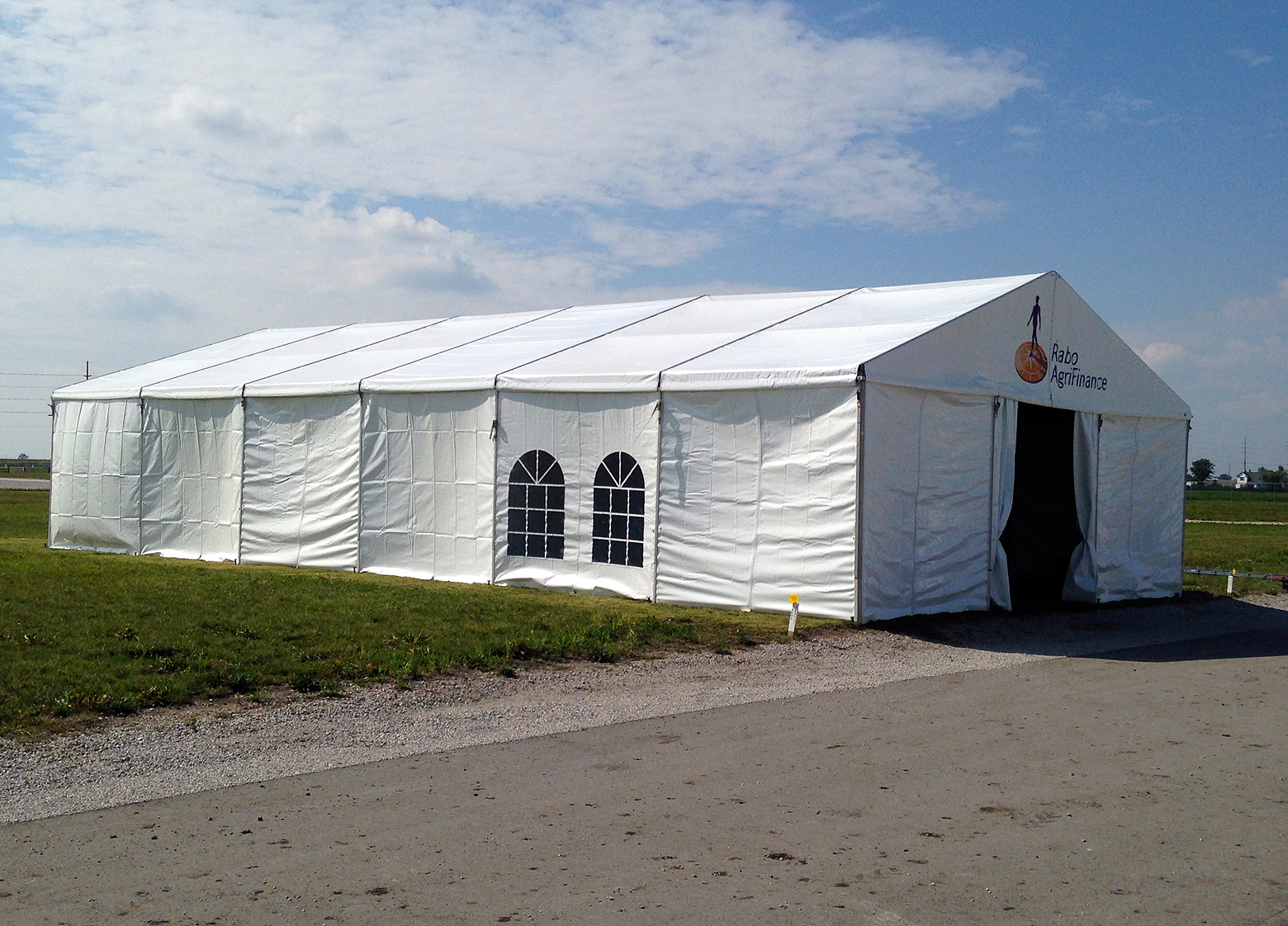 Outside the 30u2032 x 60u2032 (9m x 18m) Losberger clearspan temporary structure/ tent. & Bleacher tent u0026 party rental Aurora IL: Est. delivery fee