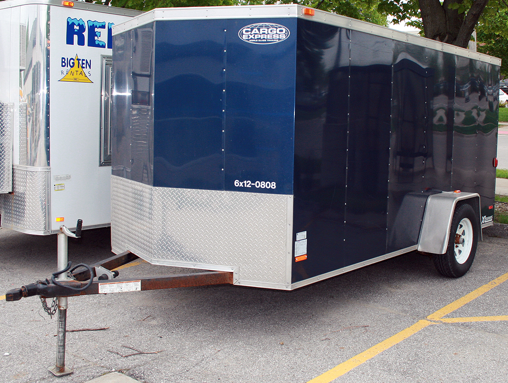 Left side of the blue 6' x 12' enclosed utility trailer.