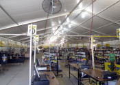 Items for sale setup inside the 18m x 60m (60′ x 197′) Losberger clearspan event structure/tent.
