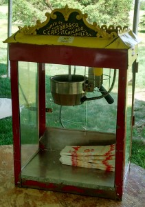 Antique popcorn machine off of the stand.