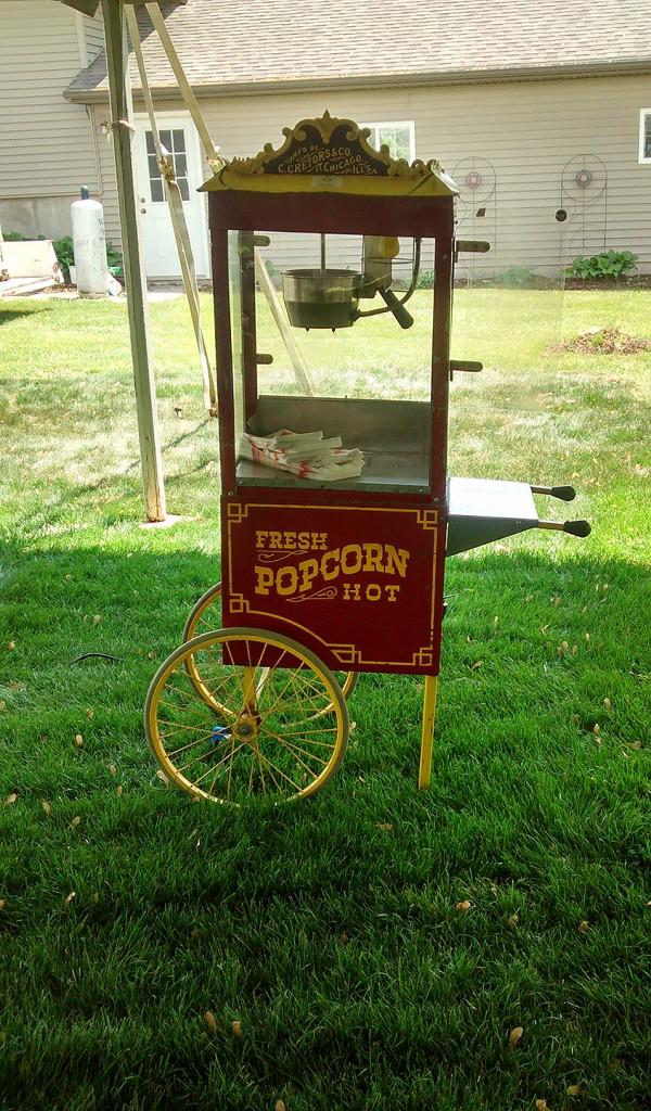 Antique popcorn machine with stand.