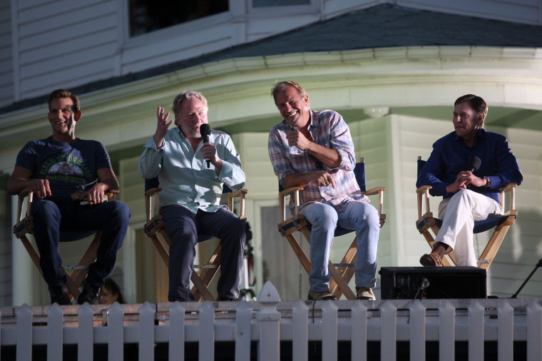 """Bob Costas (right) hosts a question and answer segment with """"Field of Dreams"""" cast members Dwier Brown (from left) Timothy Busfield, and Kevin Costner during the film's 25th Anniversary at the Field of Dreams movie site near Dyersville, Iowa, on Friday, June 13,2014."""