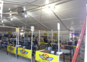 Sales/Checkout tables setup inside the 18m x 60m (60′ x 197′) Losberger clearspan event structure.