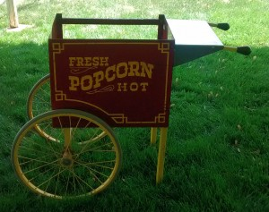 Closeup view of the stand for the antique popcorn machine.