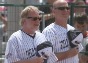 Timothy Busfield and Kevin Costner at Field of Dreams with Big Ten Rentals temporary security fencing in the back.