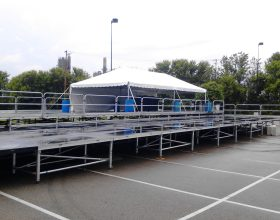Crowd view of the 44′ x 88′ Multi-Tiered Stage with tent